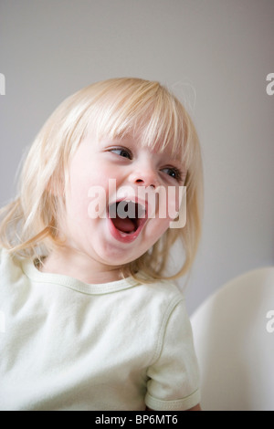 A young girl laughing - Stock Photo