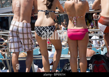 Rear view of people in swimming suits on a cruise ship - Stock Photo