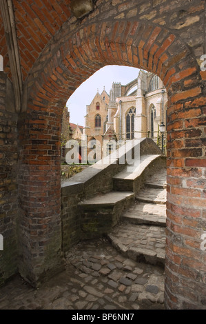 Church of our Lady (Onze-Lieve-Vrouwekerk) and the smallest bidge of the city, Historic centre of Bruges, Belgium - Stock Photo