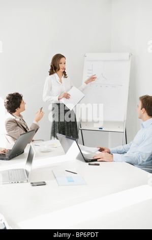 Businesswoman giving presentation in a meeting - Stock Photo