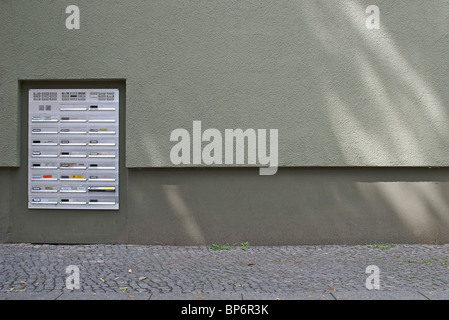 Mailboxes in the front courtyard of an apartment building - Stock Photo