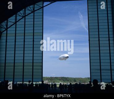 Viewed from his hangar doors, the modern airship dirigible Zeppelin NT, Friedrichshafen airport, Baden-Württemberg, - Stock Photo