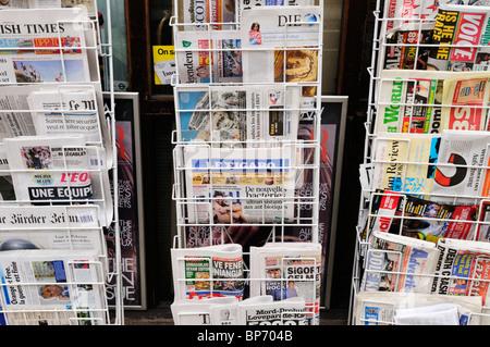 International Newspapers on sale, London, England, UK - Stock Photo