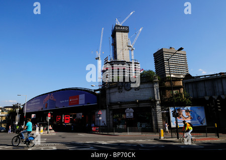 London Bridge Station entrance and The Shard Skyscraper under construction, London, England, UK - Stock Photo