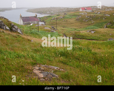 Croft Houses, Isle of Barra, Scotland - Stock Photo