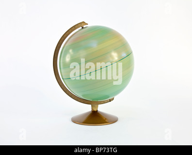Fast spinning vintage globe of the world. - Stock Photo