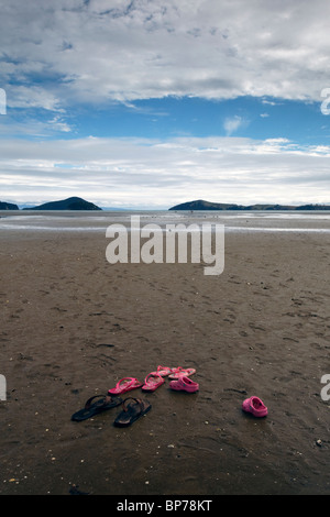 Sandles on Shelly Beach in the Coromandel, New Zealand. - Stock Photo