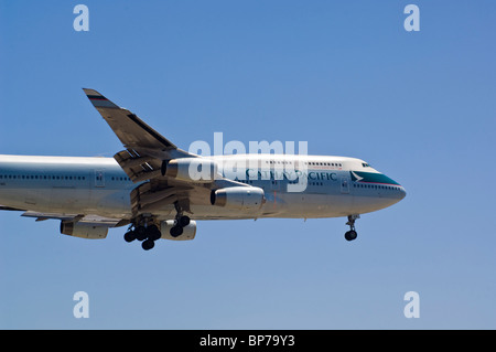 Cathay Pacific Boeing 747-400 landing at Los Angeles Int'l Airport, Los Angeles, California - Stock Photo
