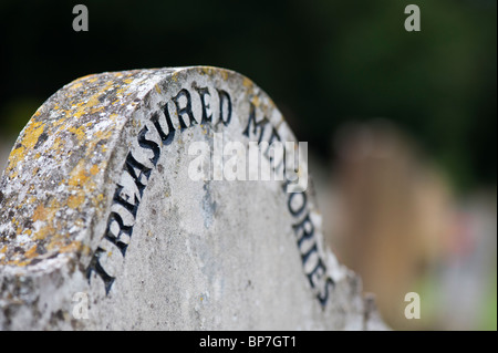 Treasured memories gravestone in churchyard - Stock Photo