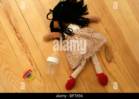 Child's ragdoll, dummy and bottle - Stock Photo