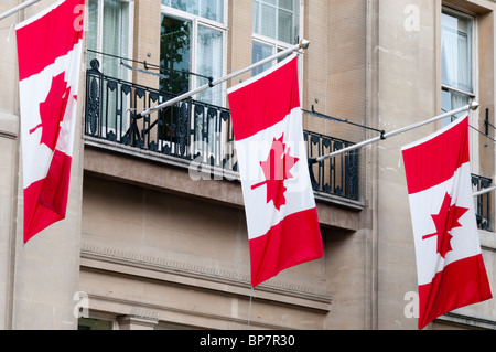 The Canadian national flag flying from Canada House on Trafalgar Square, London - Stock Photo