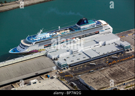 aerial view above Norwegian Cruise Lines NCL Norwegian Sky ship docked Port of Miami Florida - Stock Photo