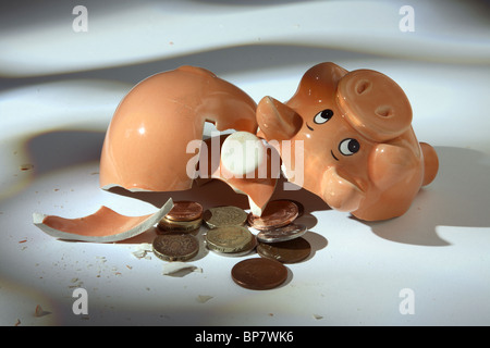 Broken piggy bank - Stock Photo