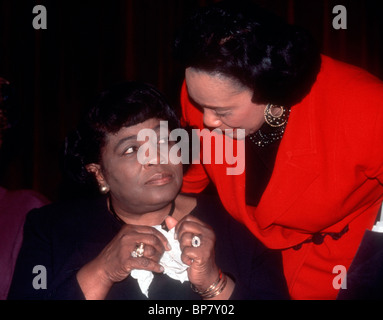 Coretta Scott King (R) widow of Martin Luther King Jr. speaks with Betty Shabazz (L), widow of Malcolm X in New - Stock Photo
