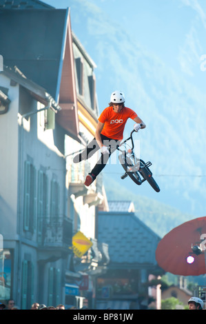 BMX bike tricks performed in Chamonix Mont Blanc, the heart of the French Alps. - Stock Photo