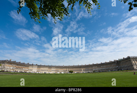 Royal Crescent townhouses and the Park. A wide angle view of Bath's famous Royal Crescent - Stock Photo