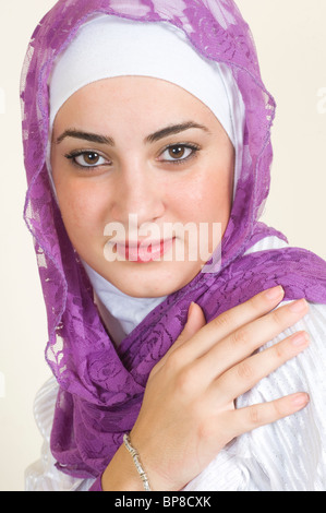 beautiful young Muslim woman hand over shoulder - Stock Photo