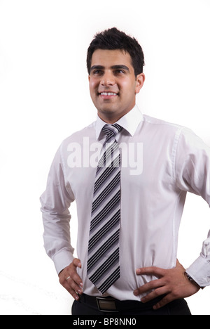 Young Middle Eastern business man wearing tie and shirt standing hands on hips looking up smiling against a white - Stock Photo