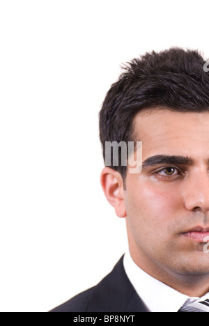 Closeup portrait of a young Middle Eastern man looking cutout against a white background - Stock Photo