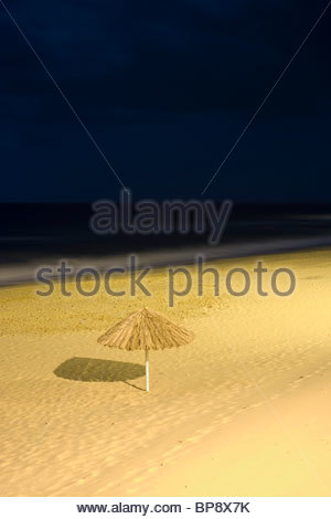 Porto Santo beach umbrella at night, Porto Santo, near Madeira, Portugal - Stock Photo