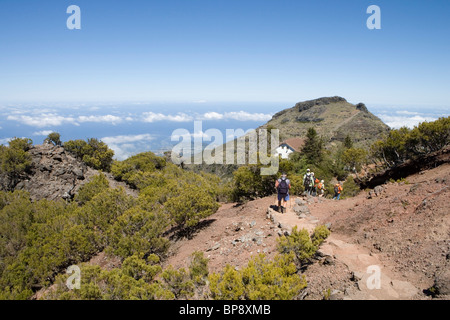 Hikers descend from Summit of Pico Ruivo Mountain, Pico Ruivo, Madeira, Portugal - Stock Photo