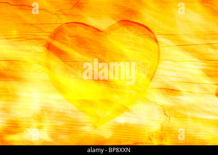 Burning heart. Red heart pattern engraved on old wood with fire. textured effect. - Stock Photo