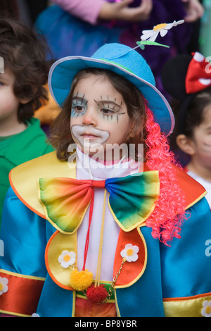 Girl dressed up as a clown at Carnival, Funchal, Madeira, Portugal - Stock Photo