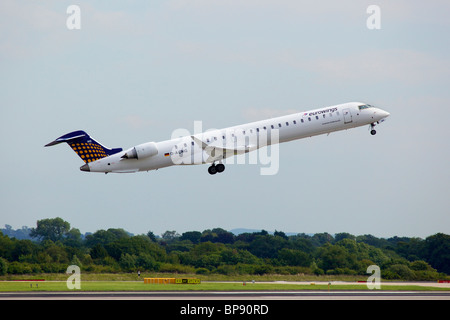 Aircraft aeroplane jet plane manchester airport jetliner Bombadier CRJ900 Eurowings - Stock Photo