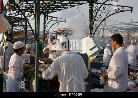 Chefs at a food stall on Djemaa el Fna Square, Marrakesh, Morocco, Africa - Stock Photo