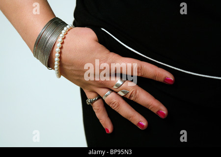 Hand with rings and bracelets - Stock Photo