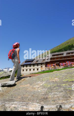Female hiker near hut Berliner Huette, Zillertal, Zillertal Alps, Tyrol, Austria - Stock Photo