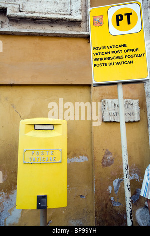 A mailbox and a sign of the Vatican Post Office, Vatican City - Stock Photo