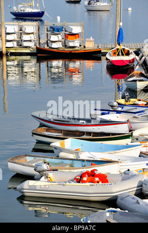 Rockland Harbor Maine with colorful boats skiffs dinghies sailboats moored to pier dock quay vertical - Stock Photo