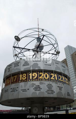 World time clock and tv tower Alexanderplatz Berlin city Germany - Stock Photo