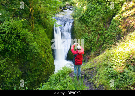 Oregon, United States Of America; A Man Taking A Picture Of Middle Oneonta Falls In Columbia River Gorge National - Stock Photo