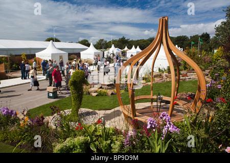 UK, England, Merseyside, Southport Flower Show, Victoria Park,visitors admiring show garden - Stock Photo