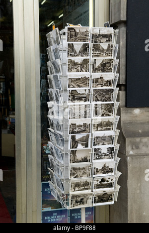 Postcards stand outside souvenir shop in Berlin Germany - Stock Photo