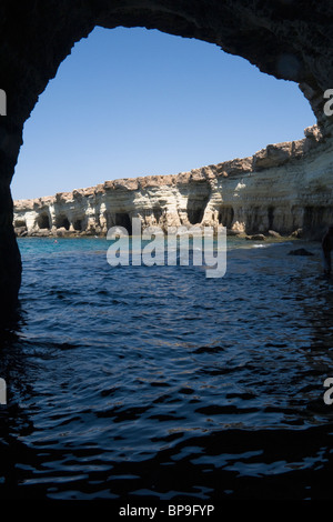 Looking out from a natural cave at the Sea Caves, Cavo Greco, not far from Ayia Napa, Cyprus. - Stock Photo