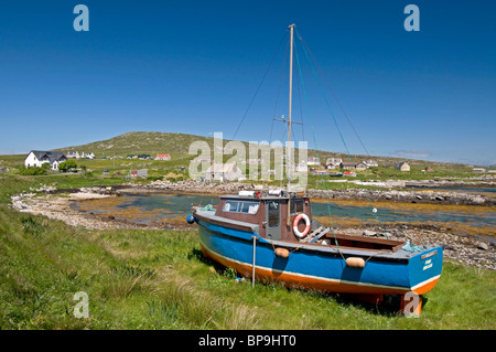 Fishing Boat ashore above the high water mark at Brough Isle of Berneray, Outer Hebrides. Western Isles. Scotland. - Stock Photo