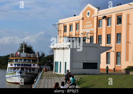 Tourist boat on Guaiba river and Usina do Gasometro Cultural Center, Porto Alegre, Rio Grande do Sul, Brazil - Stock Photo