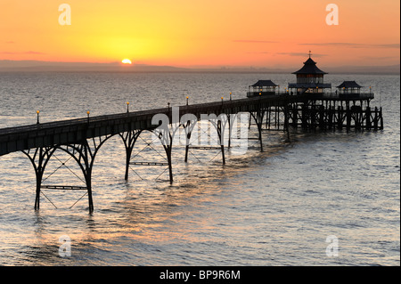 The pier at Clevedon, North Somerset, at sunset. Clevedon Pier is the only fully intact, Grade 1 listed pier in - Stock Photo
