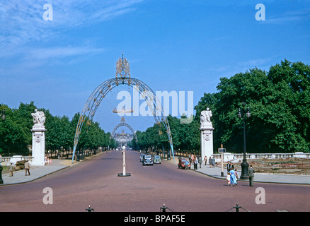 The Mall in London with the decorative arches still in place shortly after the Coronation of Elizabeth II on 2 June - Stock Photo