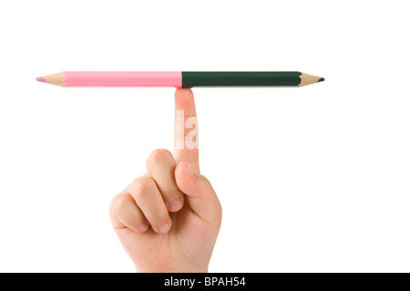 Two color pencil and hand, Concept of balance - Stock Photo