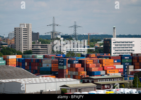 Shipping containers stacked up at Southampton Docks in Southampton, England. - Stock Photo