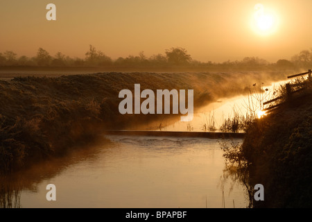 Mist rising off the River Brue in Baltonsborough, Somerset on a cold winter morning. - Stock Photo