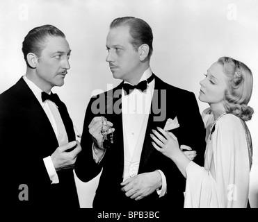 WARREN WILLIAMS, VIRGINIA BRUCE, MELVYN DOUGLAS, ARSENE LUPIN RETURNS, 1938 - Stock Photo