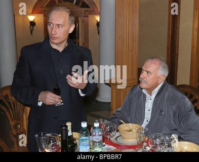 Russian President Vladimir Putin congratulates Nikita Mikhalkov on his 60th anniversary - Stock Photo