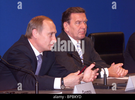 President Vladimir Putin and German Chancellor Gerhard Schroeder answer journalists question at the press conference - Stock Photo