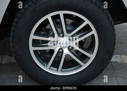 Jeep Grand Cherokee 3.0 CRD - MY 2005 (WK) - US popular large off-road 4x4 vehicle - wheel (tire and rim) - Stock Photo