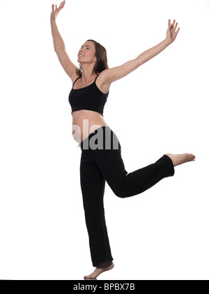 pregnant caucasian woman exercise balance isolated studio on white background - Stock Photo